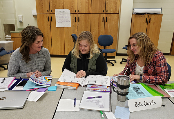 From left, students Staci Marvin, Beth Gerrits and Kristie Schwab work together in a TECAP class at UW-Stout.