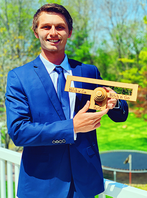 UW-Stout graduate Weston Knutson with a prototype of the Hitch N' Go.