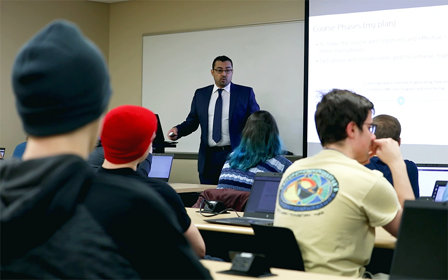 Saleh Alnaeli, who teaches computer science, lectures in a class at UW-Stout.