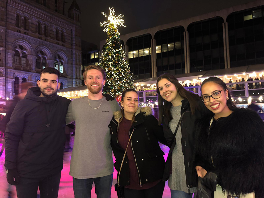 Maxwell Corner, second from left, enjoys a holiday celebration in Europe with other international students.