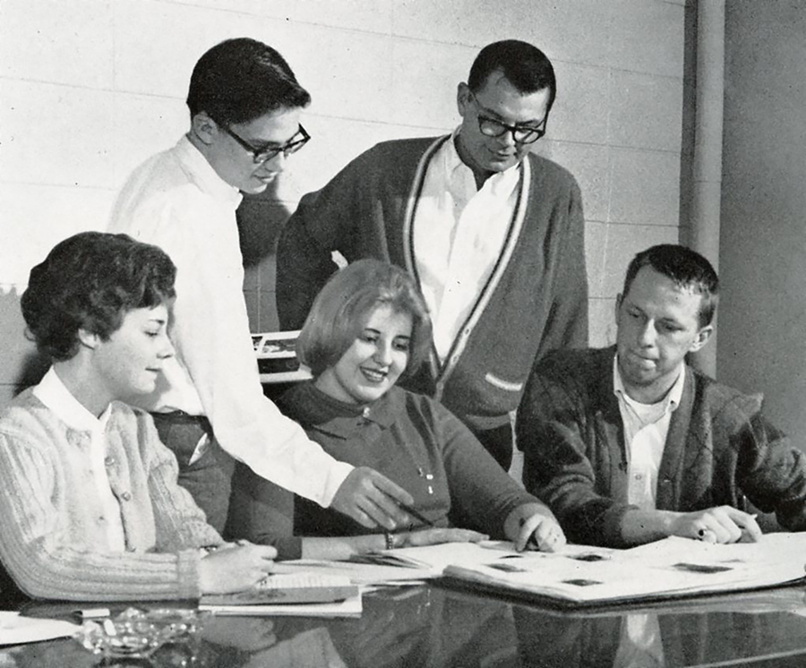 Becky Cranston, left, meets with members of the Tower yearbook staff in 1963.