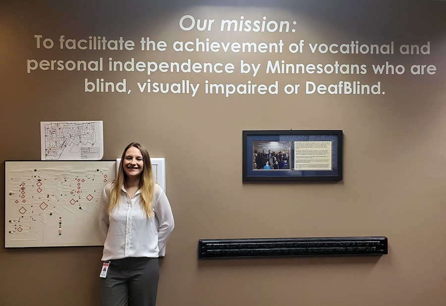 Natasha Jerde, who has two degrees in rehabilitation from UW-Stout, stands by the Minnesota State Services for the Blind mission statement in St. Paul.
