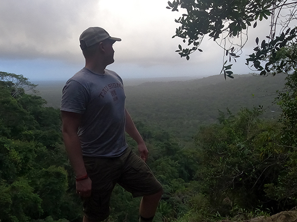 Chris Jones enjoys a scenic overlook in January in Belize while taking the UW-Stout Winterm course Natural History of the Neotropics.