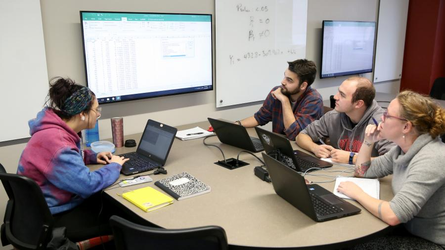 Students discuss research during Assistant Professor Zach Raff's Quantitative Research Methods class in Harvey Hall Wednesday, November 15, 2017.