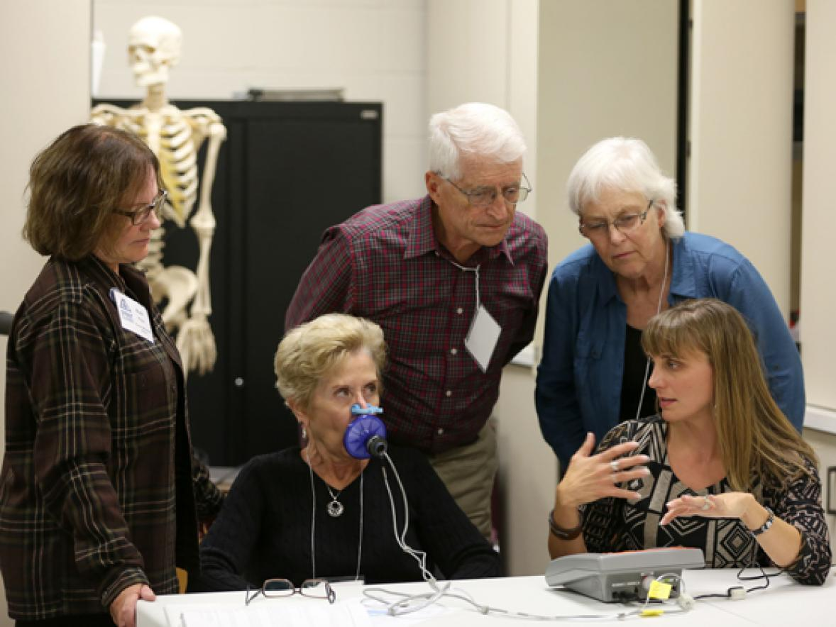 UW-Stout Associate Professor Kerry Peterson, front right, explains food pathogens during a demonstration at the 2016 Stout Summit.
