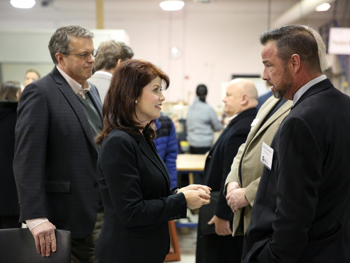 ​  Bob Rosendahl of Menomonie speaks with Lt. Gov. Rebecca Kleefisch and Discovery Center Executive Director Randy Hulke, left, at the UW-Stout Fab Lab after an announcement that the university would receive $50,000 as part of the Wisconsin Economic Development Council Entrepreneurship Support Program. / UW-Stout photo by Brett Roseman ​
