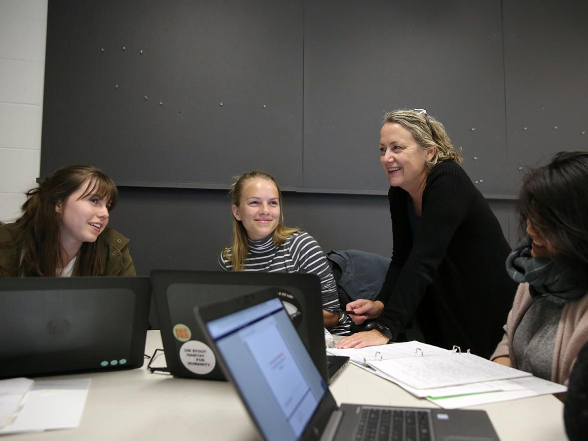 UW-Stout Professor Maureen Mitton, director of the Interior design Bachelor of Fine Arts program, talks with students during a recent interior design class. Mitton has been named a Most Admired Educator by Design Intelligence./ UW-Stout photo by Brett T. Roseman