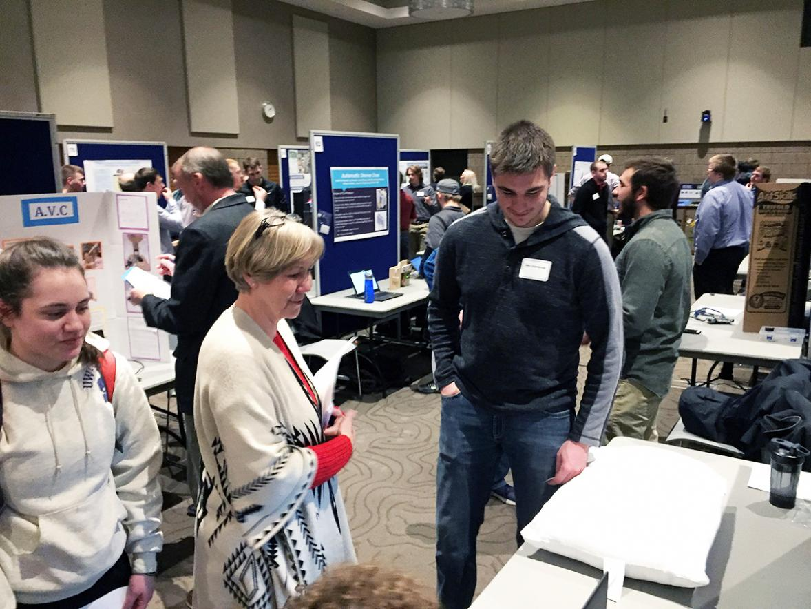 UW-Stout first-year student Ben Uitenbroek explains the design of a Bluetooth pillow alarm to Mary Spaeth, assistant professor of business./UW-Stout photos by Pam Powers