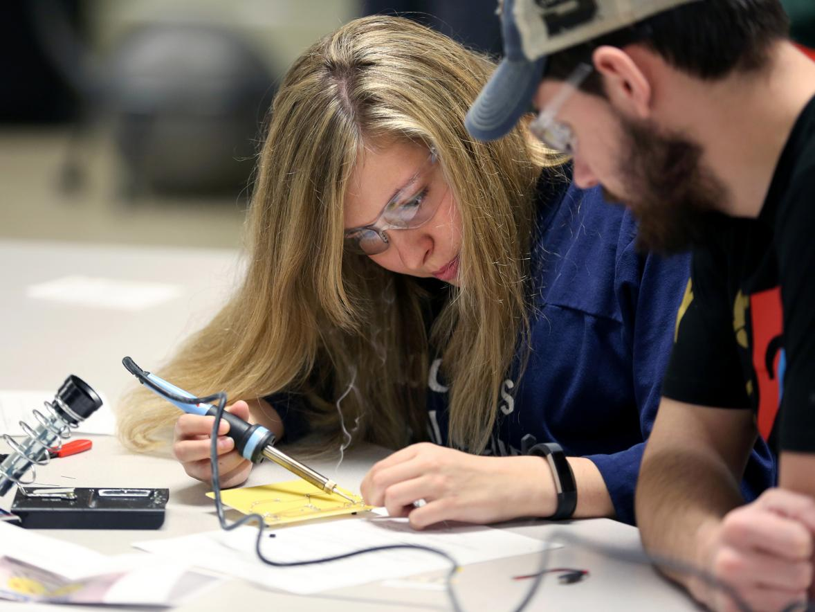 Technology education students Beth Rocque and Zak Kachel learn to solder electronic circuit components in the tech ed lab.