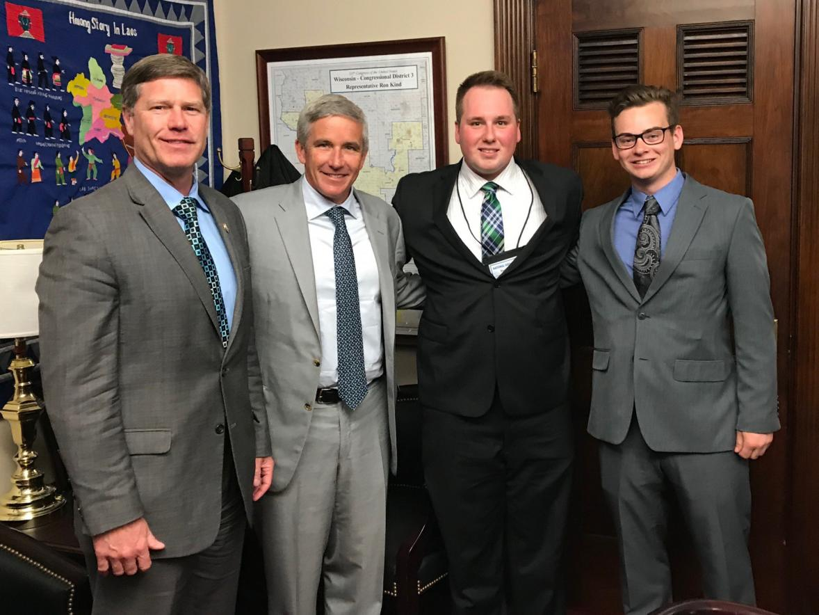 From left, U.S. Rep. Ron Kind of Wisconsin, PGA Tour Commissioner Jay Monahan and UW-Stout students Ryan Hoag and Sawyer Hrycay meet during National Golf Day.