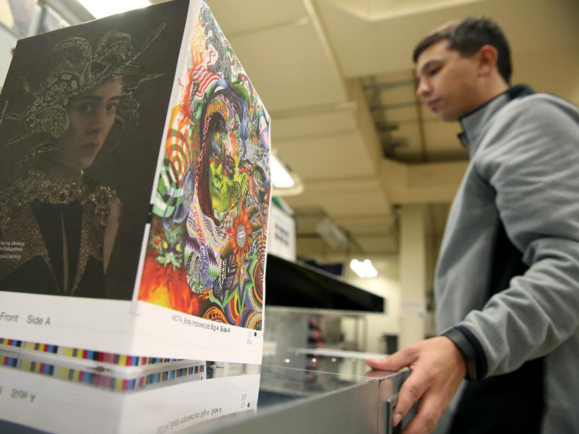 Students cut paper in a graphic communications lab at UW-Stout. A gift in kind to the department will allow students to work with the latest technologies for color management.
