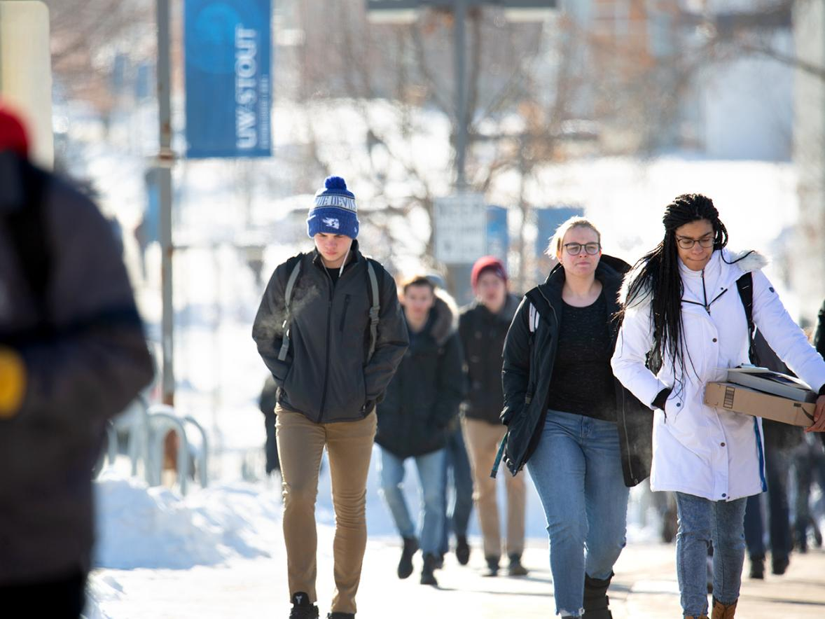 UW-Stout students walk across campus. With finals approaching and the holidays just around the corner, students might be feeling stress. / UW-Stout photo by Chris Cooper