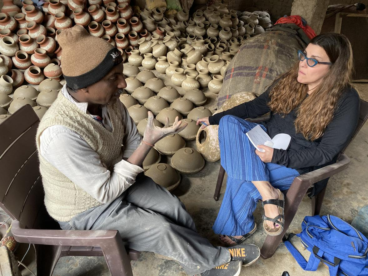 Professor Kate Maury interviews potter Jagmohan when she visited the business run by him and his brother in India.
