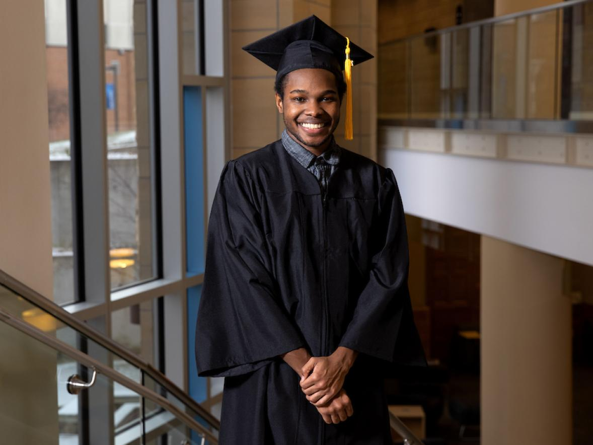 Deon Canon, double major graduate in professional communication and emerging media and applied social sciences, in the Memorial Student Center grand stairwell.