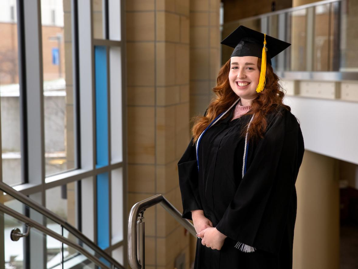 Erica Gaetz, human development and family services graduate, pictured in the Memorial Student Center grand stairwell.