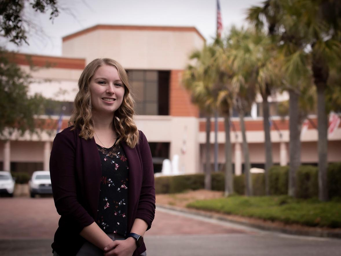 Nikki Ruf, a 2020 UW-Stout graduate, stands outside the the Naval Information Warfare Center in Charleston, S.C., where she is an IT specialist and project manager.