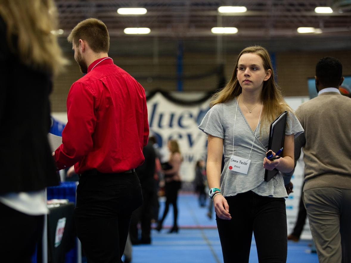 Students walk through the 2020 Spring Career Conference, held before the COVID-19 pandemic.
