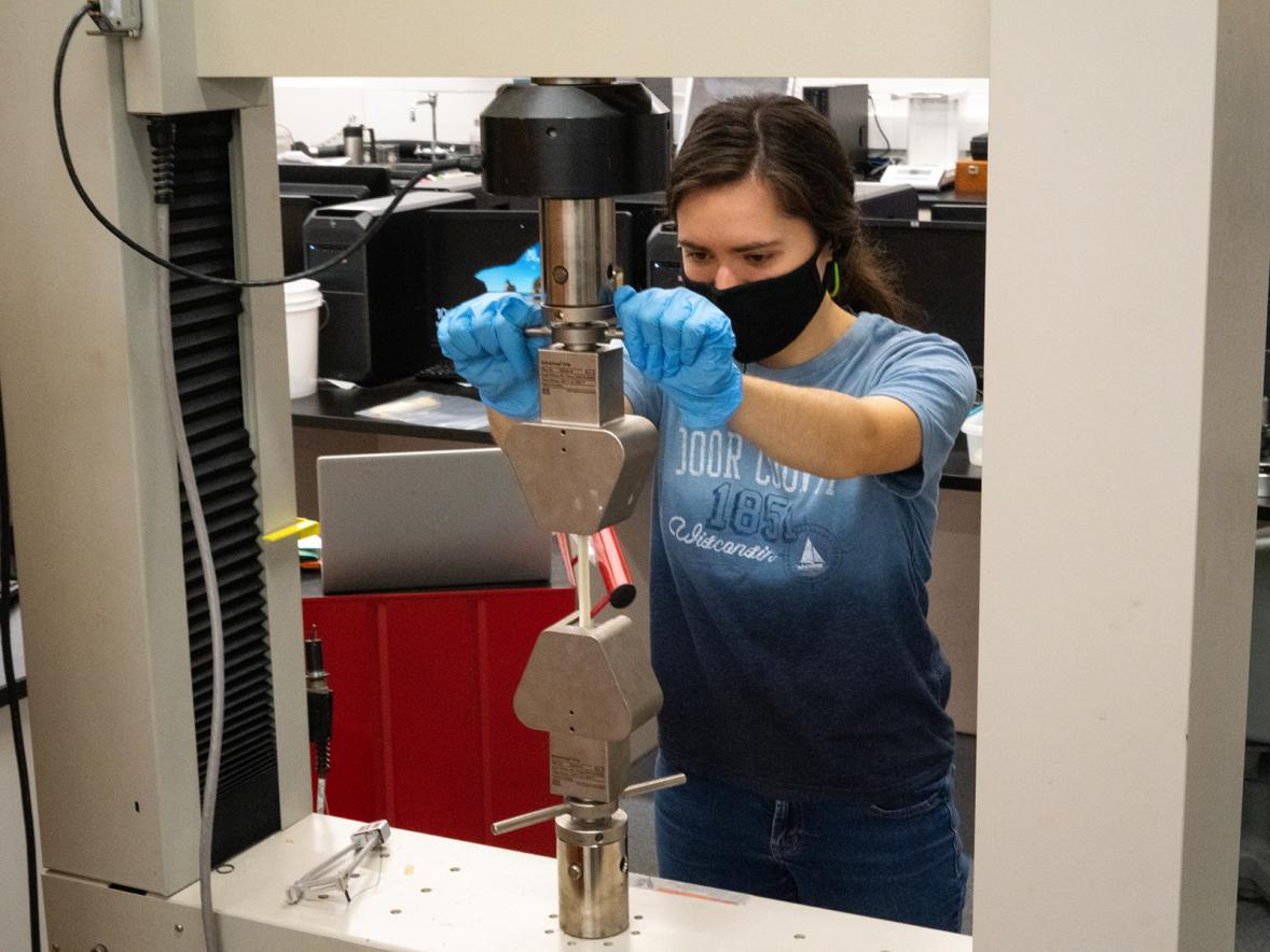 Plastics engineering major Olivia Hile works in a lab in 2020.