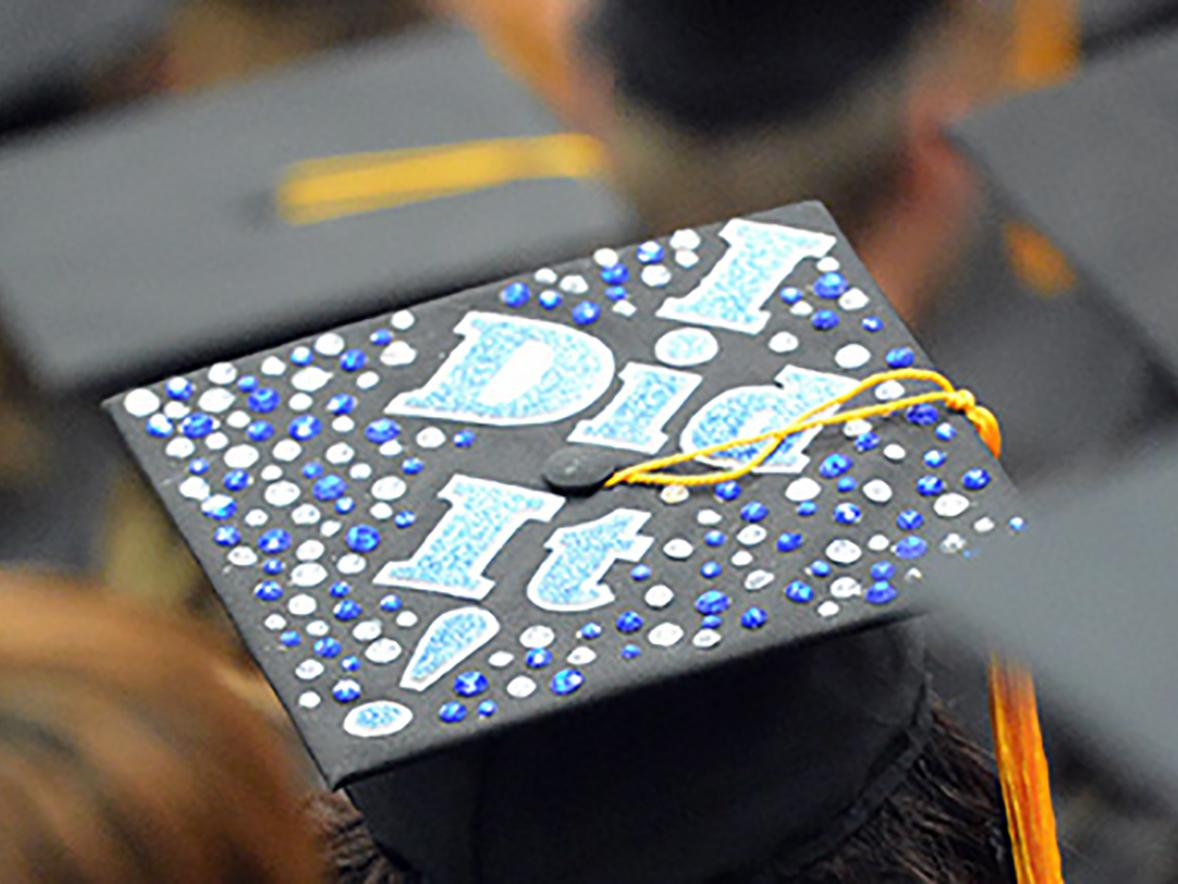 A student from a commencement ceremony prior to the pandemic celebrated with a special mortarboard.