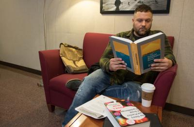 UW-Stout Graduate student Gregory Applekamp, 39, in the Rehabilitation Counseling Program, studies for an exam at the UW-Stout Robert S. Swanson Library & Learning Center.