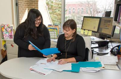Joua Lor and Erin Dunbar work within the Human Resources office.