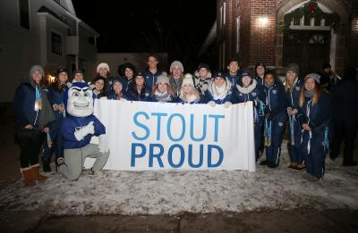 The WinterDaze parade is photographed on Thursday, December 8, 2016 on Main Street. Students and staff participated in the parade to represent the University, including the UW-Stout Cheer Team. (UW-Stout Photo by Noah Van Wyk)