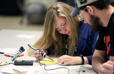UW-Stout student in an electrical circuits course in a tech ed lab.