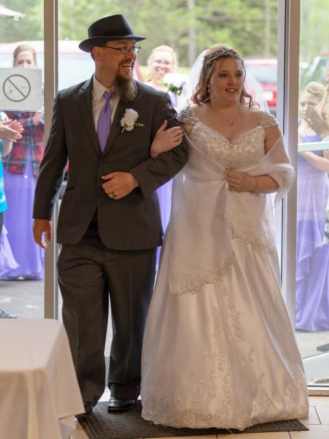 Jessica Bellomy, online psychology student, with her husband on her wedding day.