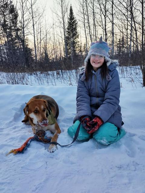 Online psychology students Jessica Bellomy's daughter and their dog.